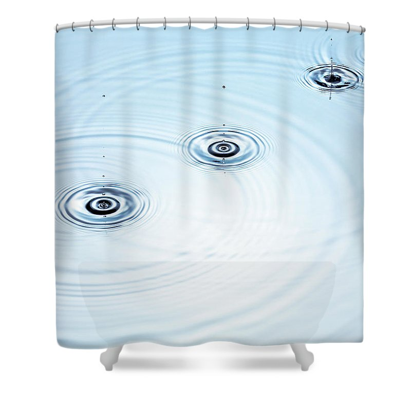 Purity Shower Curtain featuring the photograph Three Drops Of Water Falling Into A by Pier