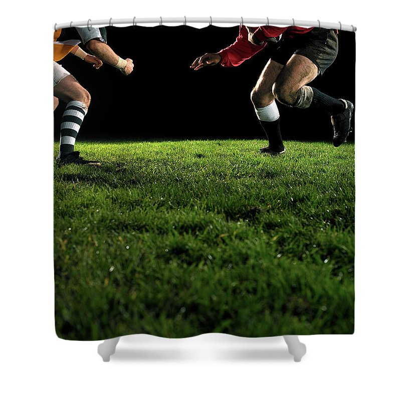 Grass Shower Curtain featuring the photograph Two Opposing Rugby Players, One Holding by Thomas Barwick