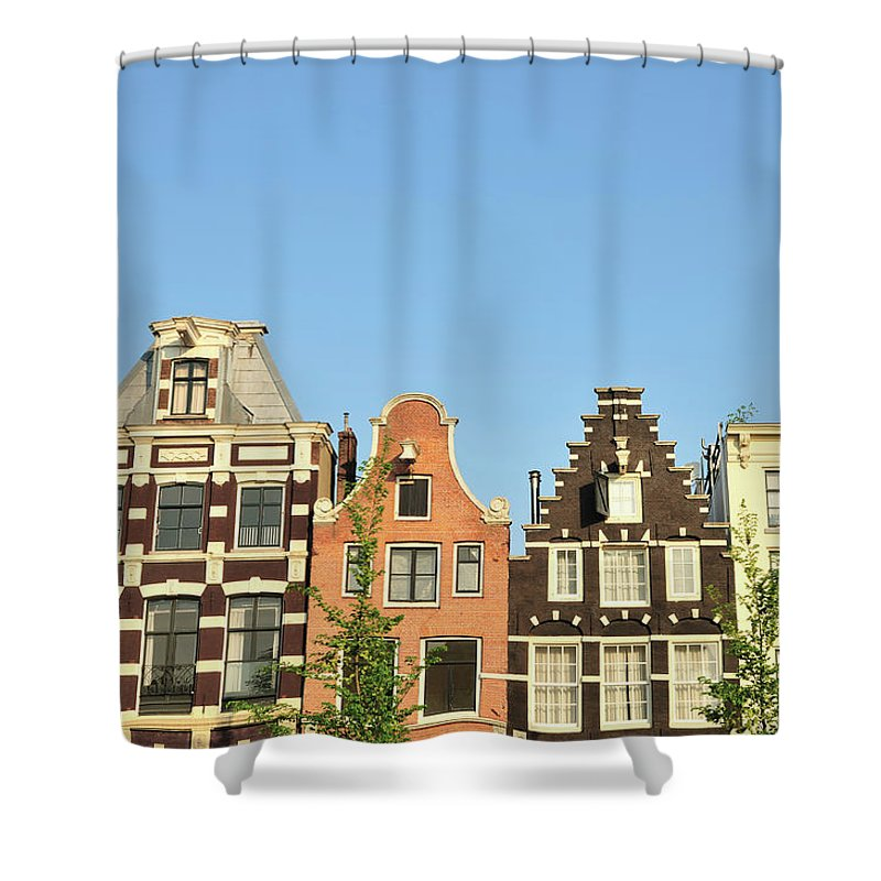 In A Row Shower Curtain featuring the photograph Typical Canal Houses, Amsterdam, The by Gorazdbertalanic