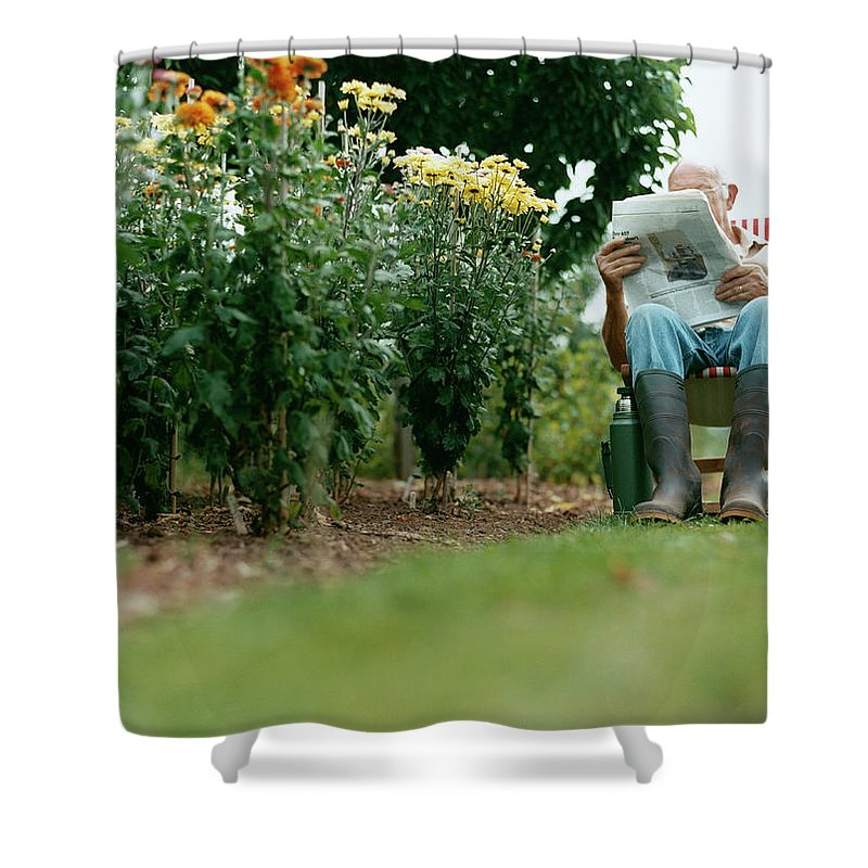 Grass Shower Curtain featuring the photograph Unrecognisable Man Sits Reading A by Iain Crockart