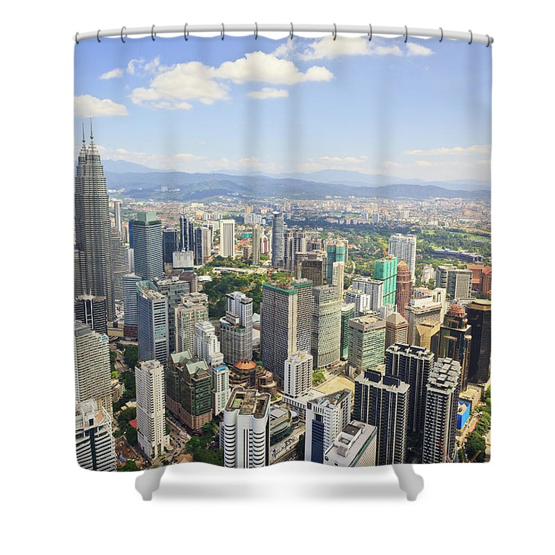 Outdoors Shower Curtain featuring the photograph View Of The Kuala Lumpur Skyline by Tom Bonaventure