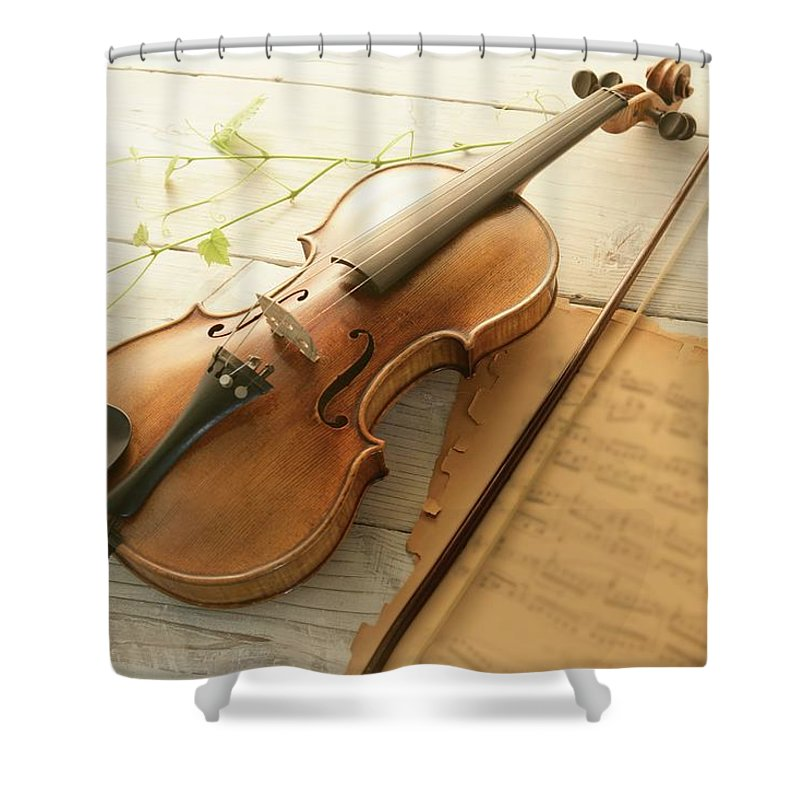 Sheet Music Shower Curtain featuring the photograph Violin And Music Sheet by Image Work/amanaimagesrf
