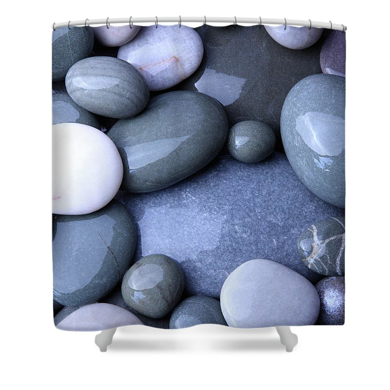 Large Group Of Objects Shower Curtain featuring the photograph Wet Granite Pebbles On Beach by Rosemary Calvert