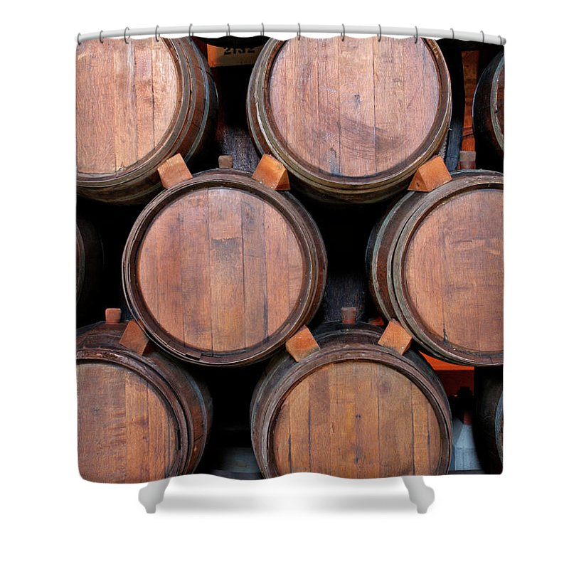 Fermenting Shower Curtain featuring the photograph Wine Barrels Stacked Inside Winery by Yinyang