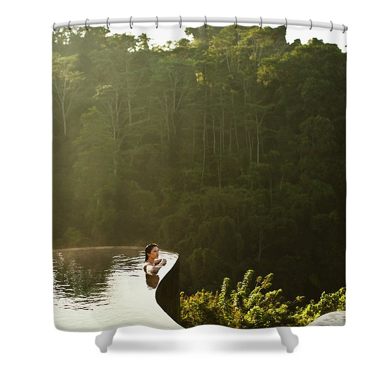 Tropical Rainforest Shower Curtain featuring the photograph Woman In Infinity Pool At Sunrise. Bali by Matthew Wakem
