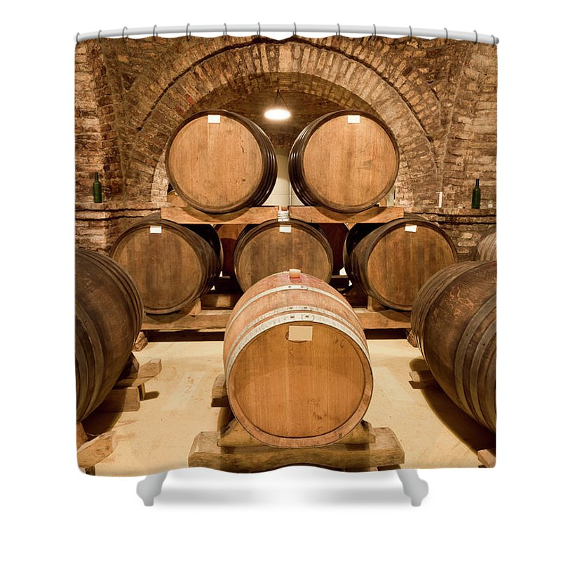 Arch Shower Curtain featuring the photograph Wooden Barrels In Wine Cellar by Benedek