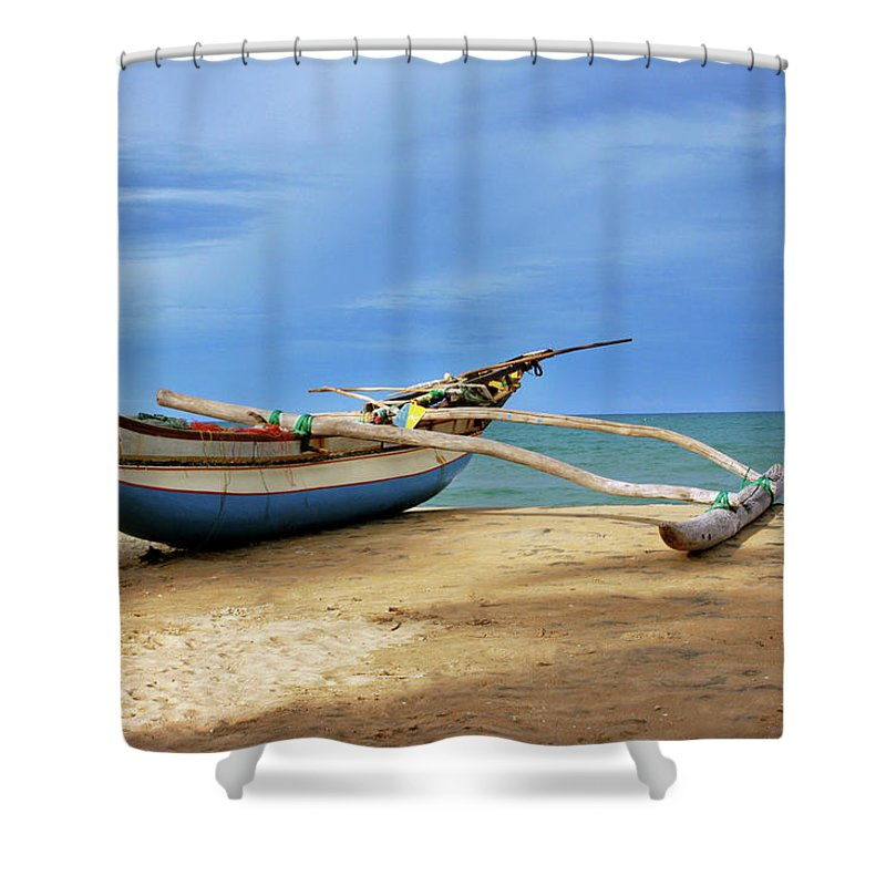Tranquility Shower Curtain featuring the photograph Wooden Catamaran By The Sea Shore by Juavenita Alphonsus