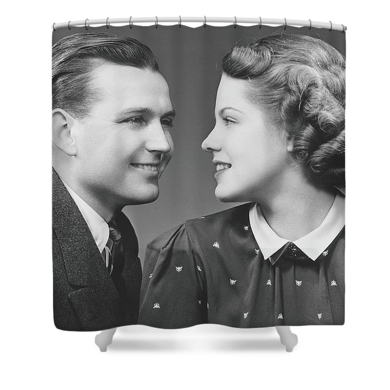 Young Men Shower Curtain featuring the photograph Young Couple Looking In Eyes In Studio by George Marks