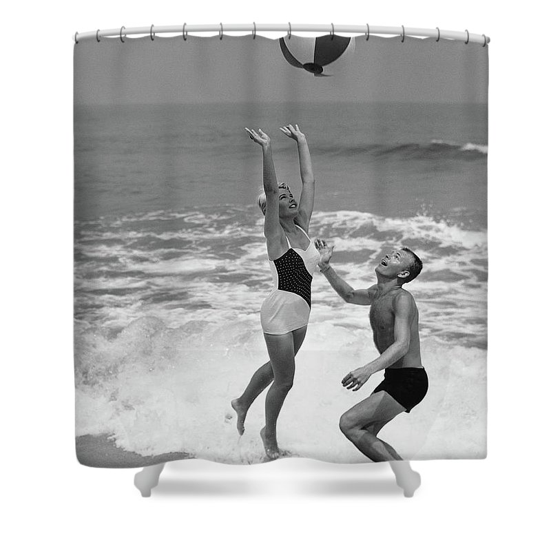 Young Men Shower Curtain featuring the photograph Young Couple Playing With Beach Ball At by Stockbyte