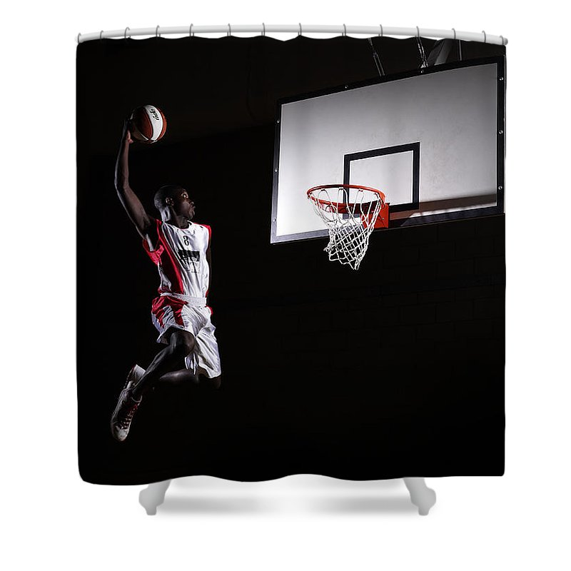 Human Arm Shower Curtain featuring the photograph Young Man In The Air About To Dunk The by Compassionate Eye Foundation/steve Coleman/ojo Images Ltd