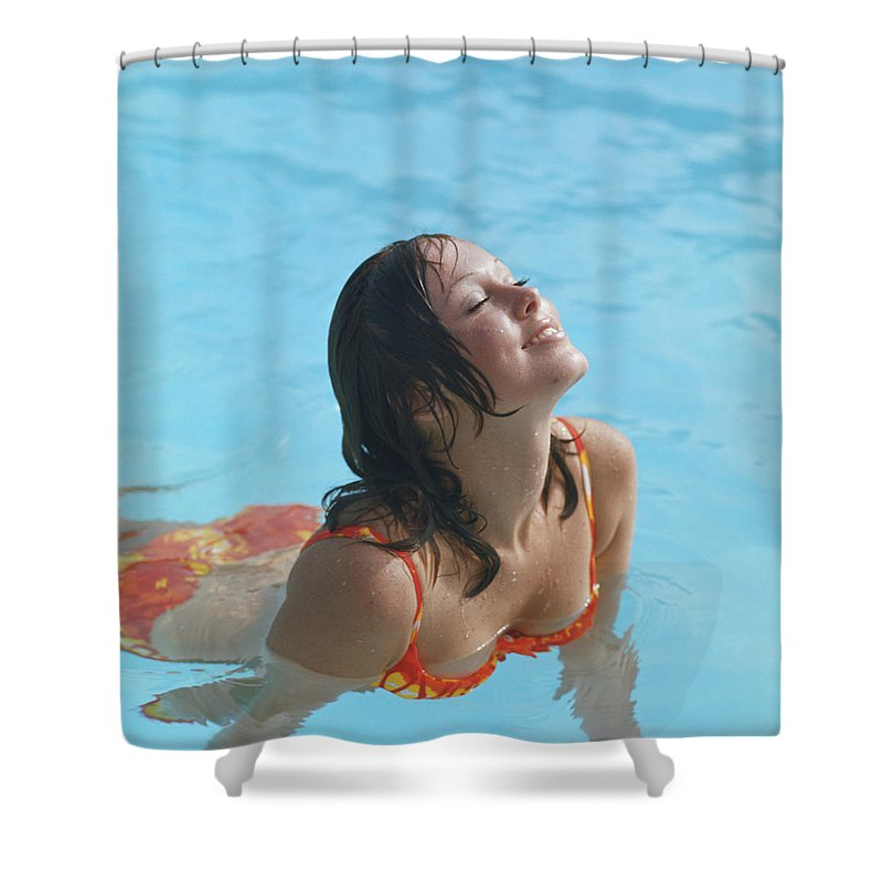 1973 Shower Curtain featuring the photograph Young Woman In Bikini At Swimming Pool by Tom Kelley Archive