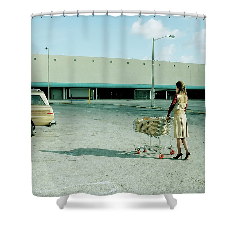 Casual Clothing Shower Curtain featuring the photograph Young Woman Pushing Trolly Full Of by Kelvin Murray