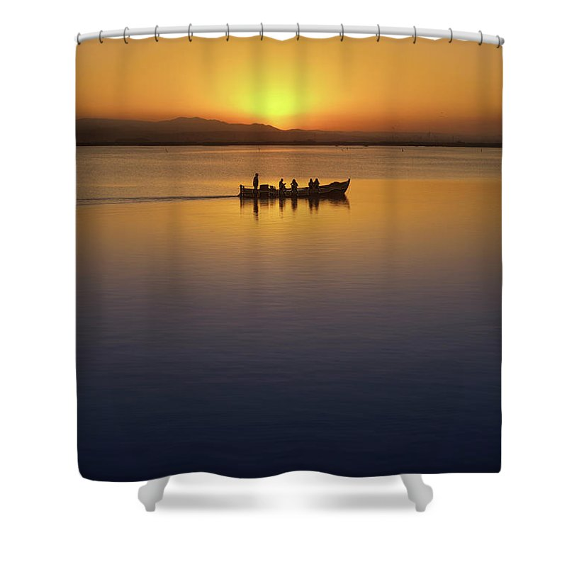 Blue Shower Curtain featuring the photograph The Boat At Sunset by Vicente Sargues