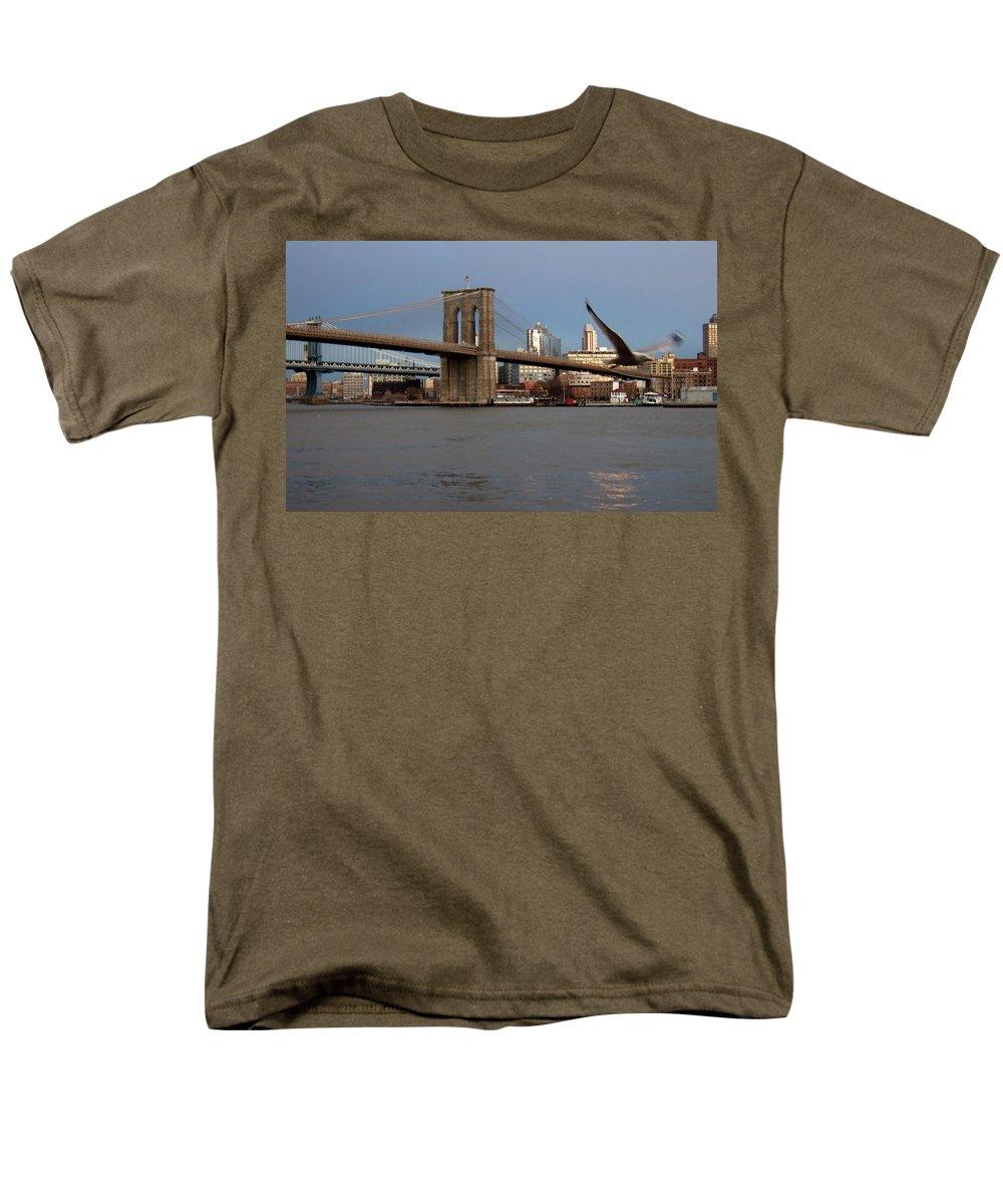 Brooklyn Bridge Men's T-Shirt (Regular Fit) featuring the photograph Brooklyn Bridge and Bird in Flight by Anita Burgermeister