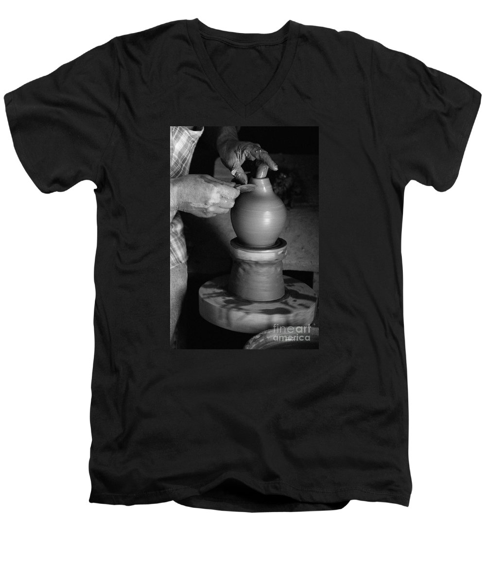 Azores Men's V-Neck T-Shirt featuring the photograph Potter At Work by Gaspar Avila