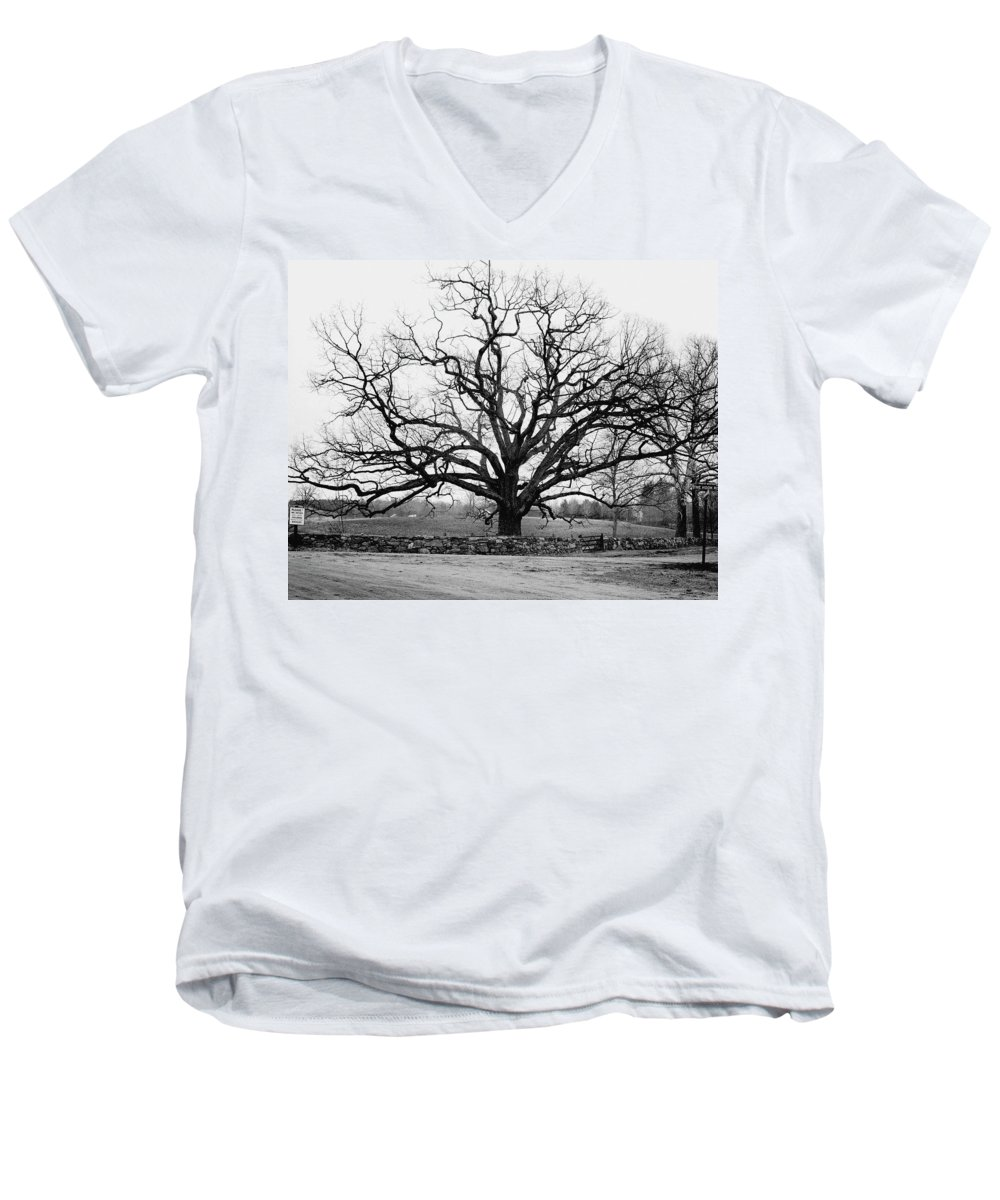Exterior Men's V-Neck T-Shirt featuring the photograph A Bare Oak Tree by Tom Leonard