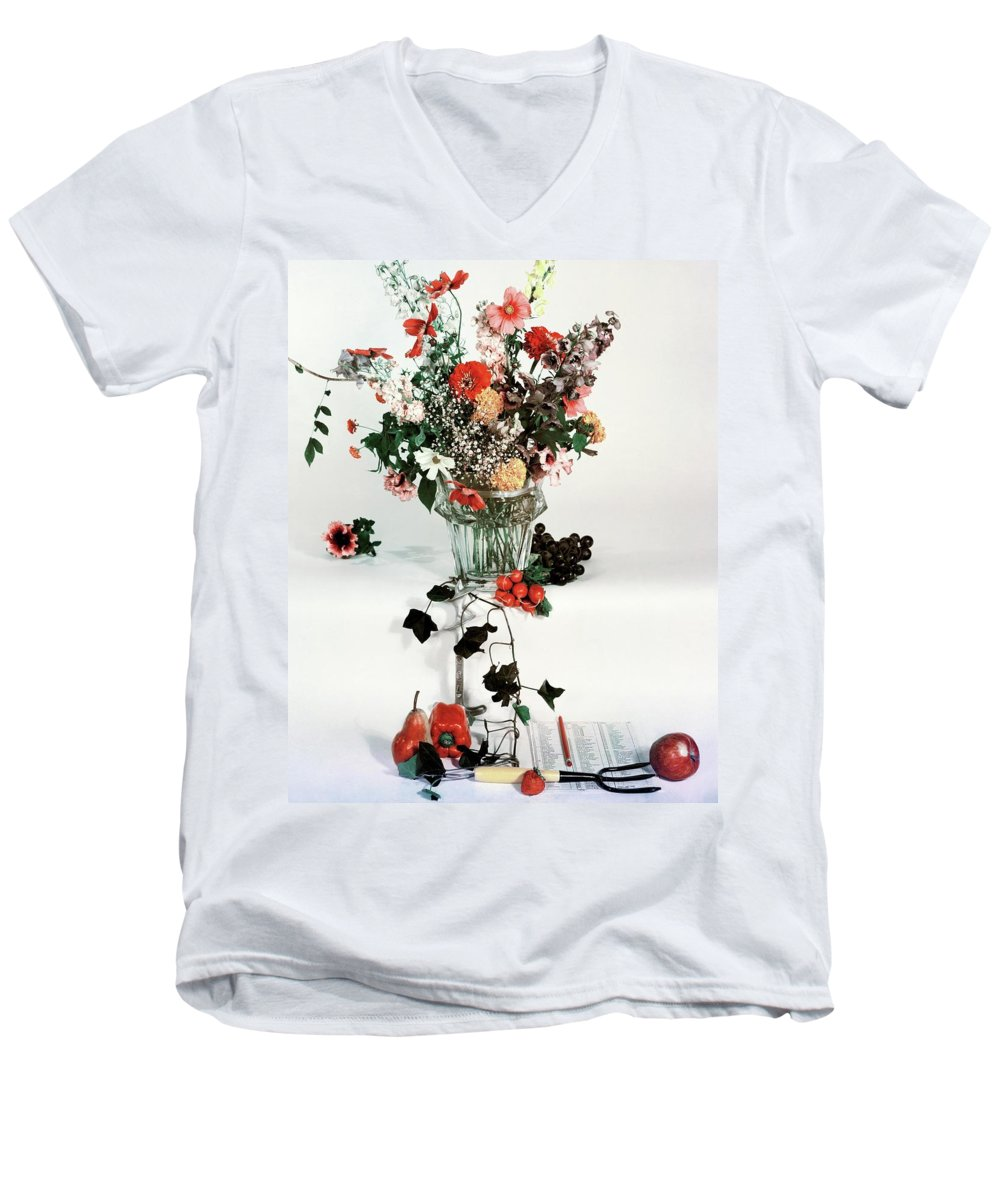 Nobody Men's V-Neck T-Shirt featuring the photograph A Studio Shot Of A Vase Of Flowers And A Garden by Herbert Matter