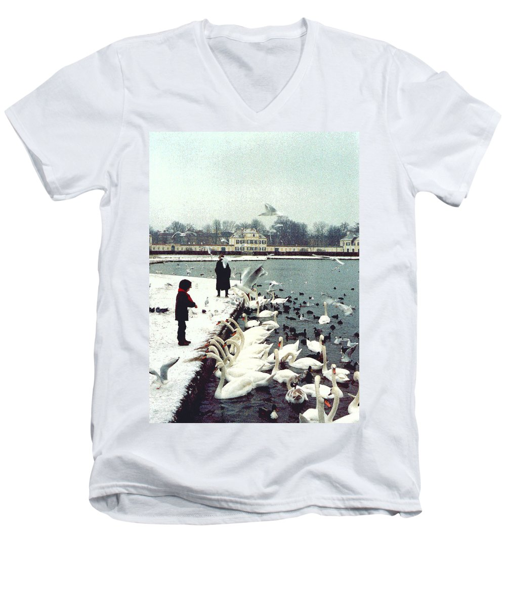 Swans Men's V-Neck T-Shirt featuring the photograph Boy Feeding Swans- Germany by Nancy Mueller