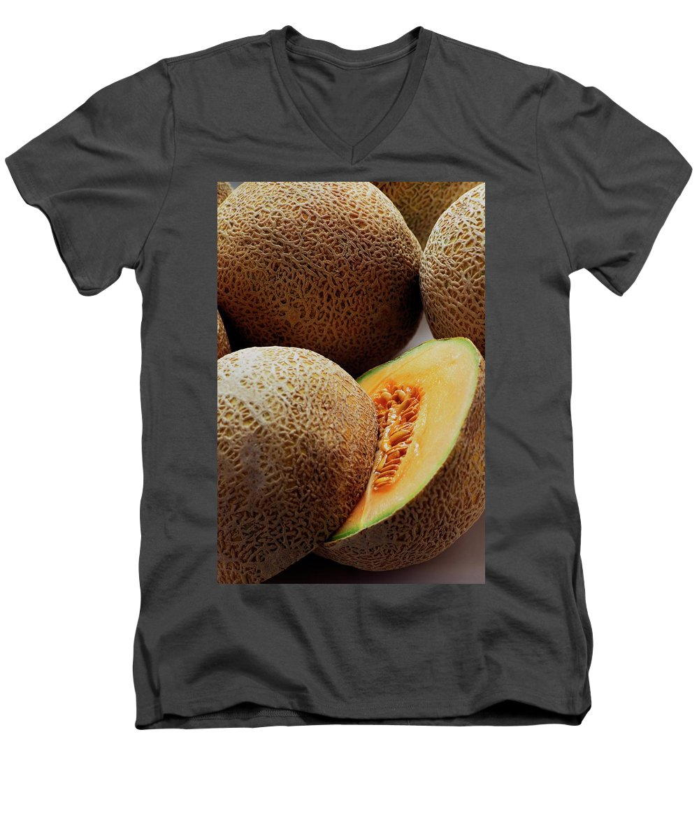 Fruits Men's V-Neck T-Shirt featuring the photograph A Cantaloupe Sliced In Half by Romulo Yanes