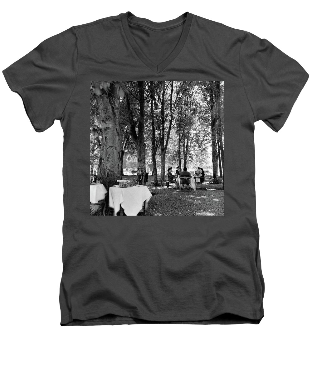 Food Men's V-Neck T-Shirt featuring the photograph A Group Of People Eating Lunch Under Trees by Luis Lemus