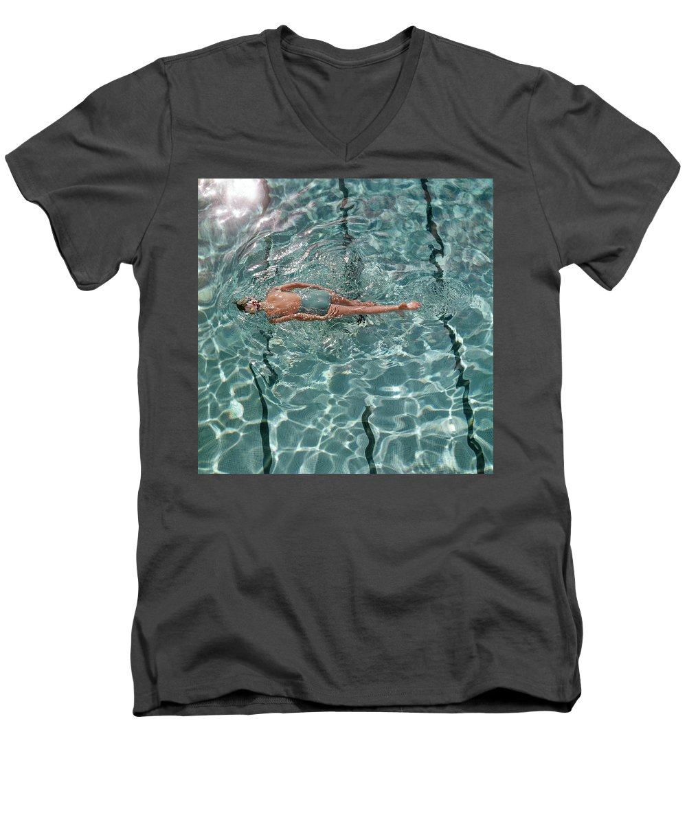 Water Men's V-Neck T-Shirt featuring the photograph A Woman Swimming In A Pool by Fred Lyon