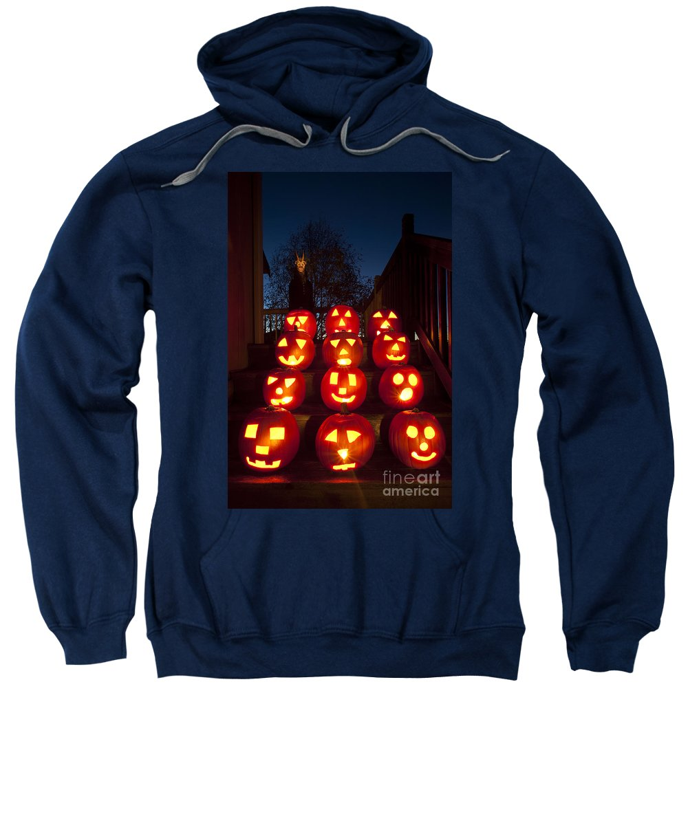 31st Sweatshirt featuring the photograph Lit Pumpkins With Demon On Halloween by Jim Corwin