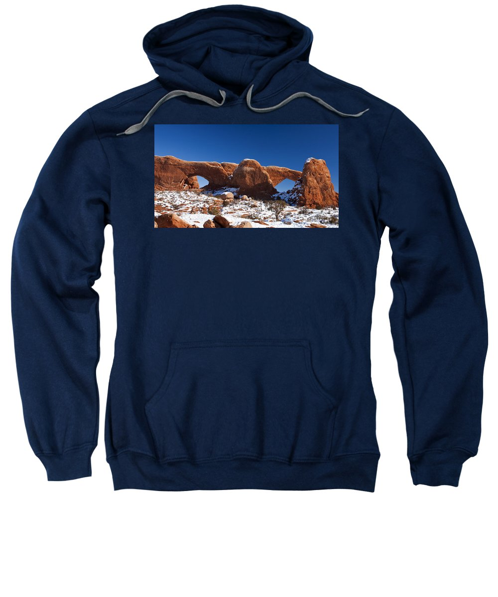 Arches Sweatshirt featuring the photograph The Windows In Snow Arches National Park Utah by Jason O Watson