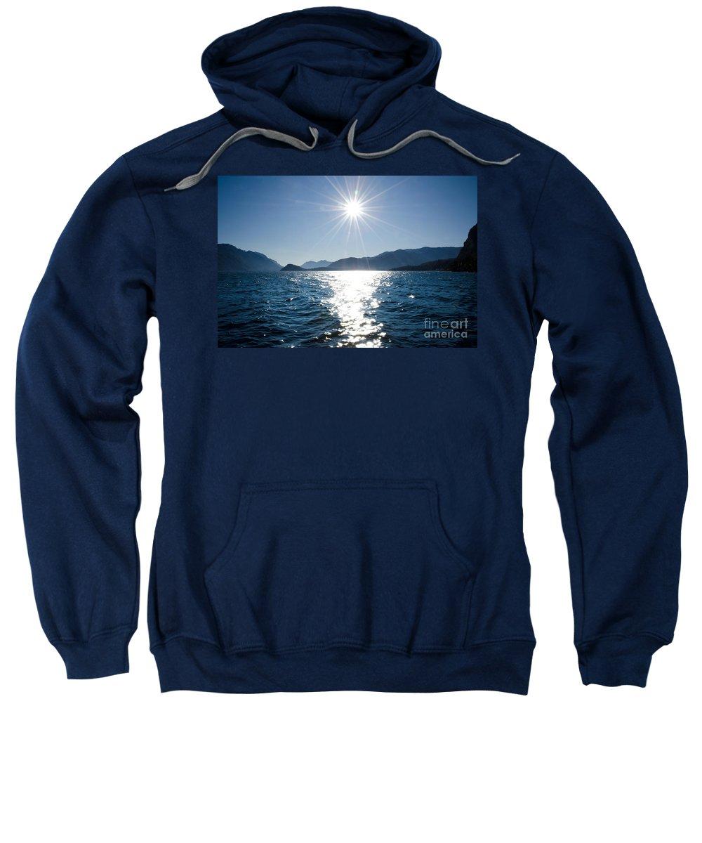 Lake Sweatshirt featuring the photograph Sunshine Over An Alpine Lake by Mats Silvan