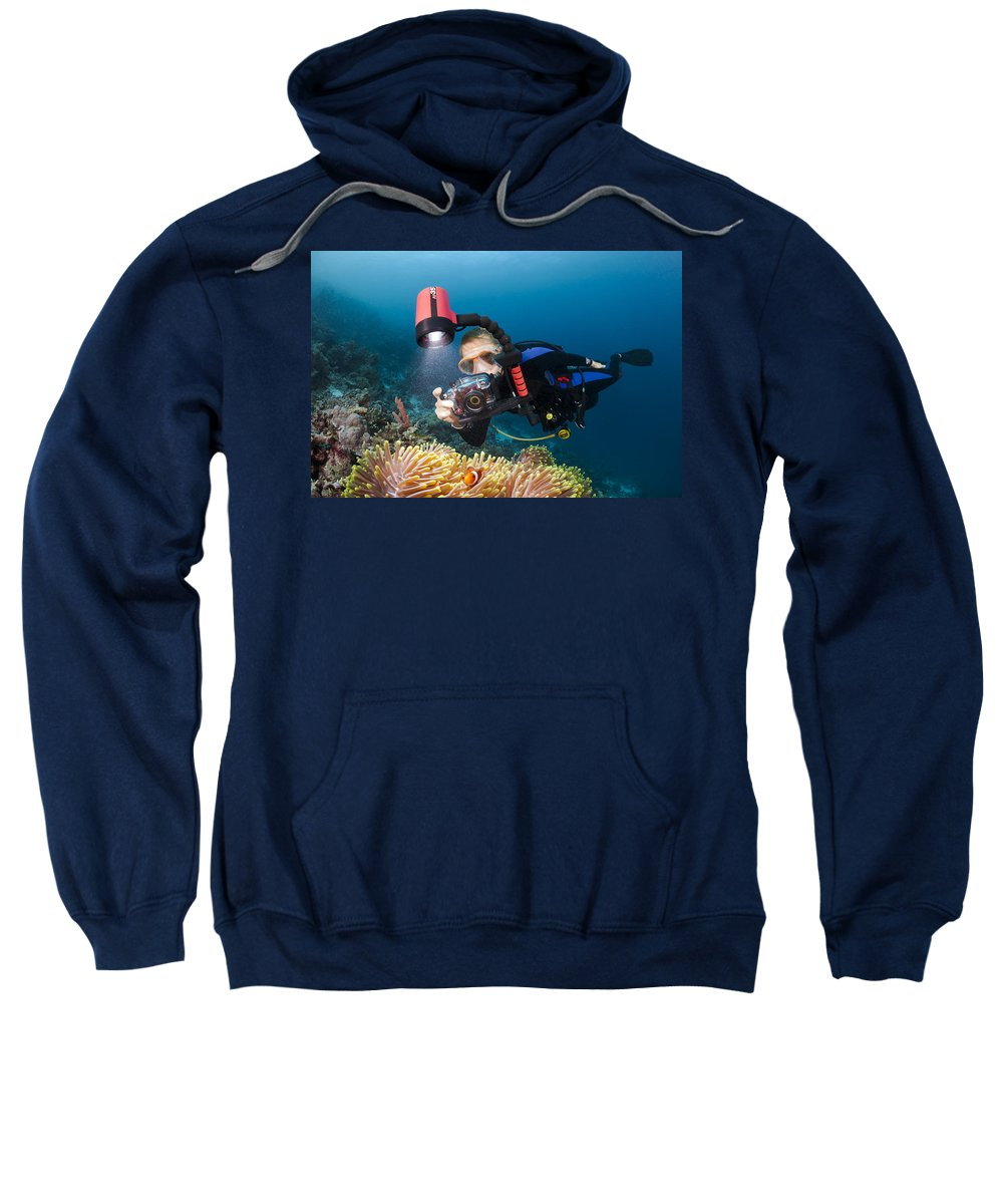 Amphiprion Sweatshirt featuring the photograph Diver And Anenome Fish by Dave Fleetham
