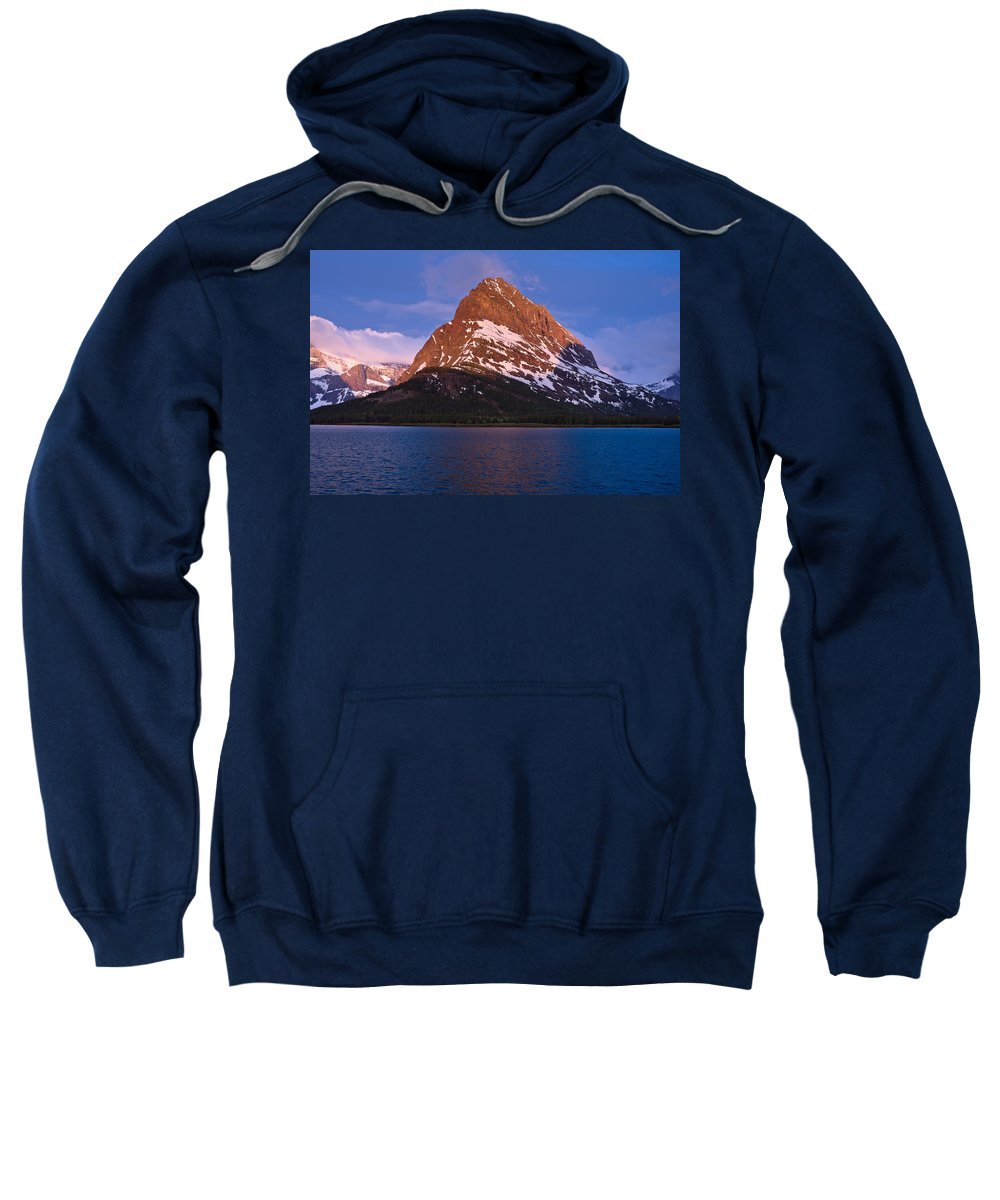 Many Glacier Sweatshirt featuring the photograph Grinnel Point At First Light by Greg Nyquist