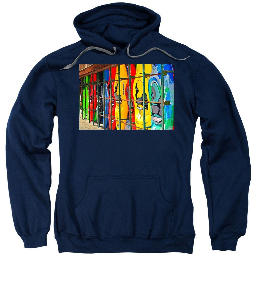Kayaks Sweatshirt featuring the photograph Kayaks In A Cage by Susan Leggett