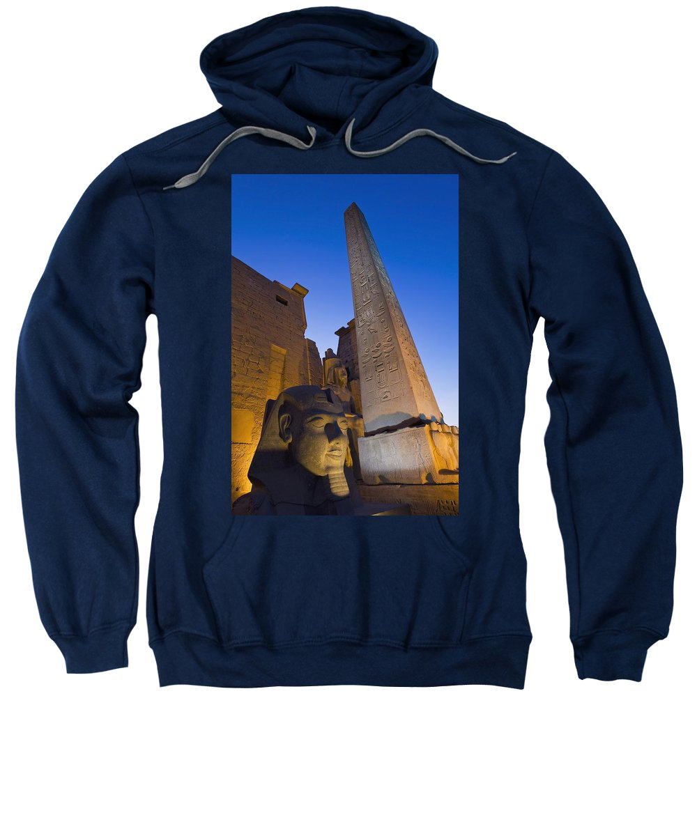 Photography Sweatshirt featuring the photograph Large Pharaohs Head Statue And Obelisk by Axiom Photographic