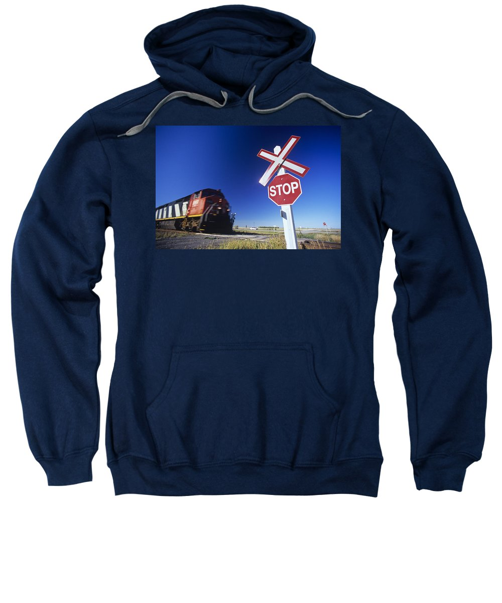 Colour Image Sweatshirt featuring the photograph Train Passing Railway Crossing by Dave Reede