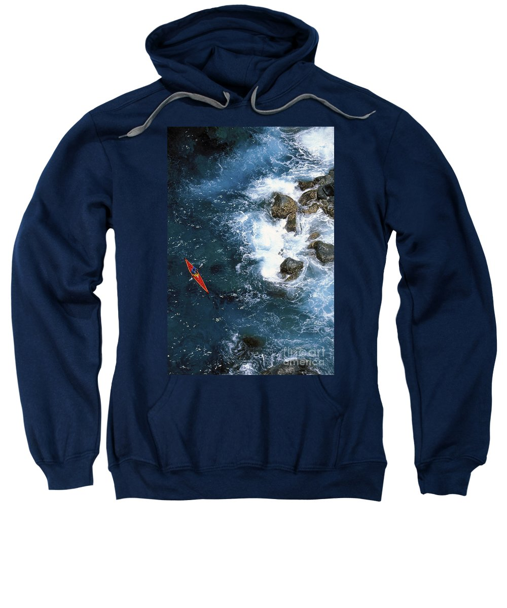 Above Sweatshirt featuring the photograph Kayaking Along Coastline by Ron Dahlquist - Printscapes