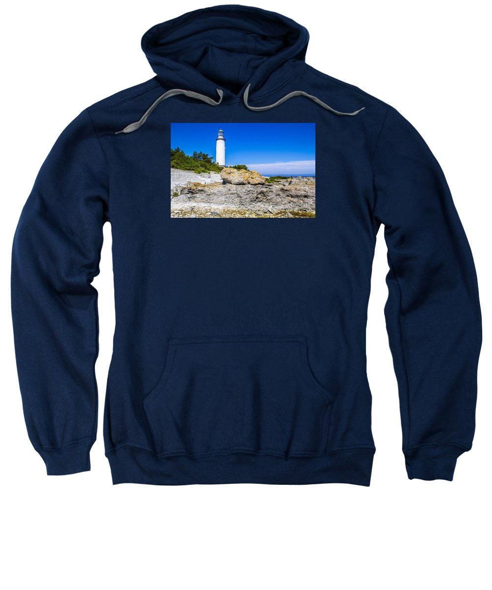 Rocks Sweatshirt featuring the photograph Lighthouse And Rocks by Roberta Bragan