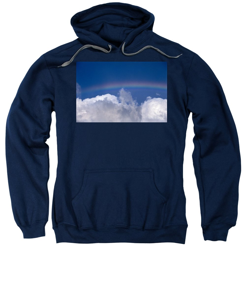 Above Sweatshirt featuring the photograph Rainbow Over Clouds by Bob Abraham - Printscapes