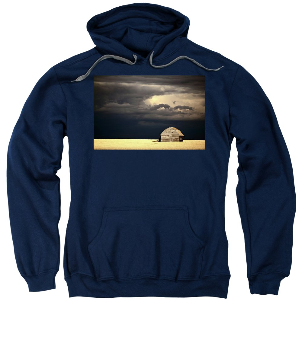 Abandoned Sweatshirt featuring the digital art Storm Clouds Behind Abandoned Saskatchewan Barn by Mark Duffy