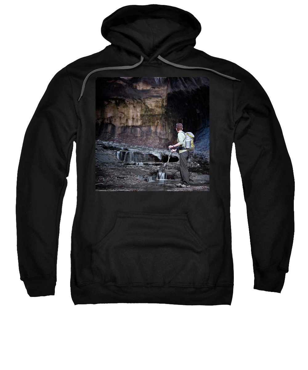 50-54 Years Sweatshirt featuring the photograph A Female Hiker With Tekking Poles by Ron Koeberer