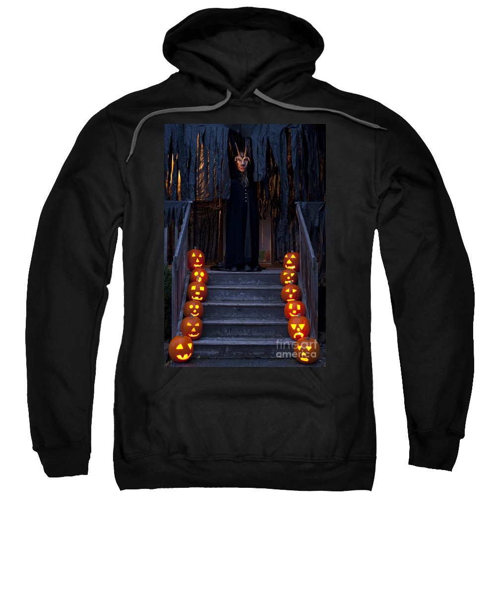 31st Sweatshirt featuring the photograph Haunted House With Lit Pumpkins And Demon by Jim Corwin