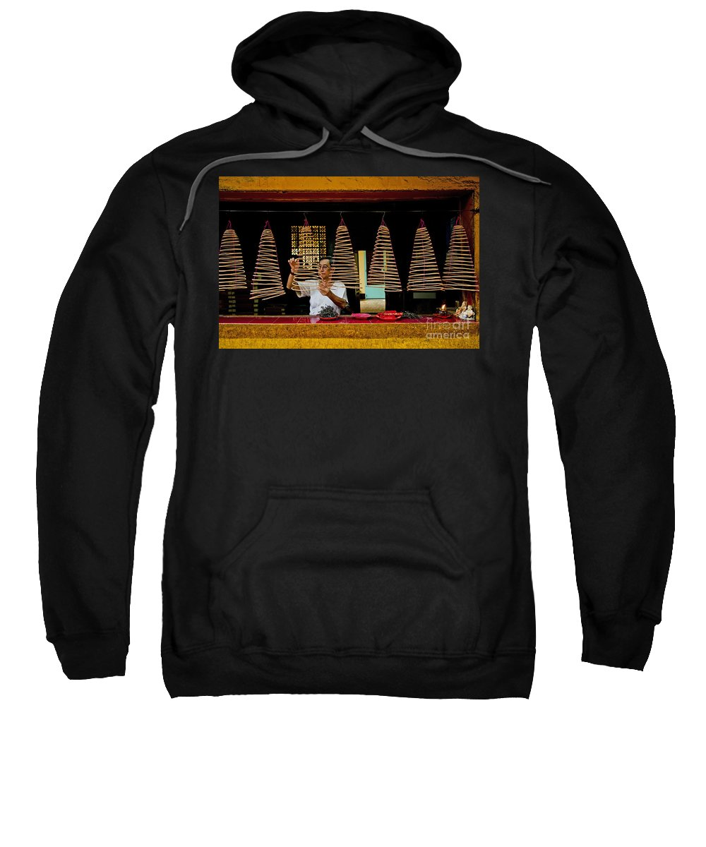 Asia Sweatshirt featuring the photograph Man Lighting Incense In Chinese Temple Vietnam by Jacek Malipan