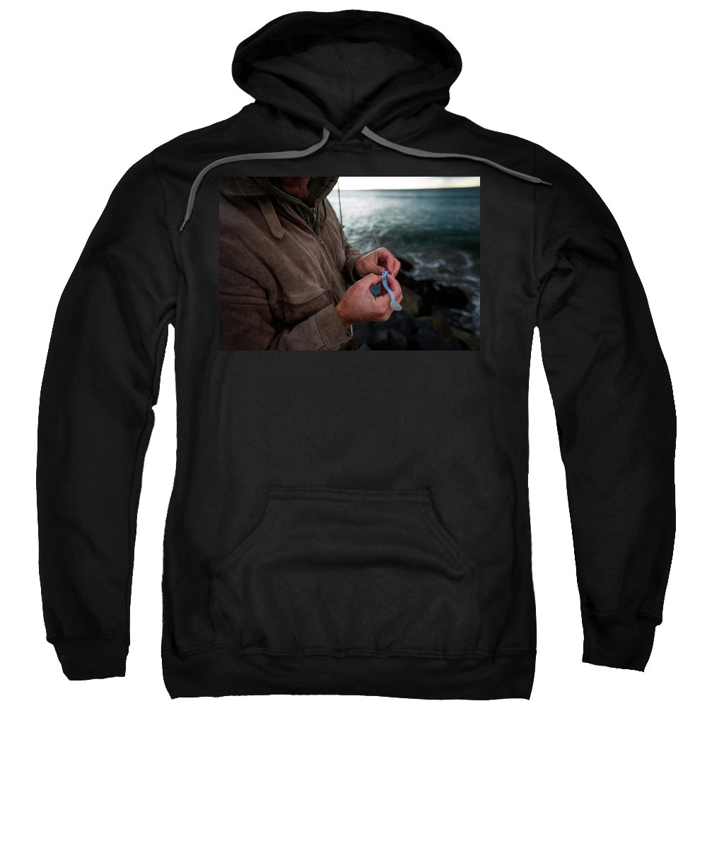 California Sweatshirt featuring the photograph Fisherman Fishing While Storm Blows by Sam Wells