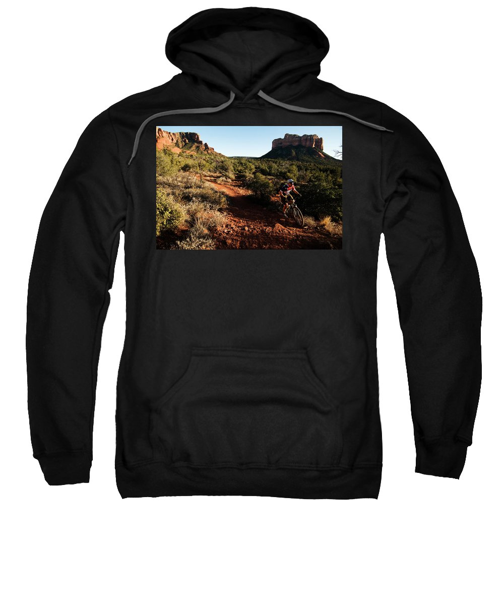 30-34 Years Sweatshirt featuring the photograph A Middle Age Man Rides His Mountain by Kyle George