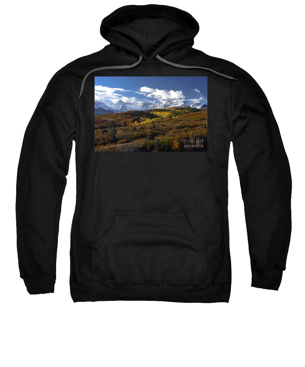 Sneffels Mountain Range San Juan Mountains Colorado Autumn Leaves Aspen Trees Tree Mountains Fall Color Colors Cloud Clouds Landscape Landscapes Snowscape Snowscapes Nature Sweatshirt featuring the photograph A Change Of Seasons by Bob Phillips