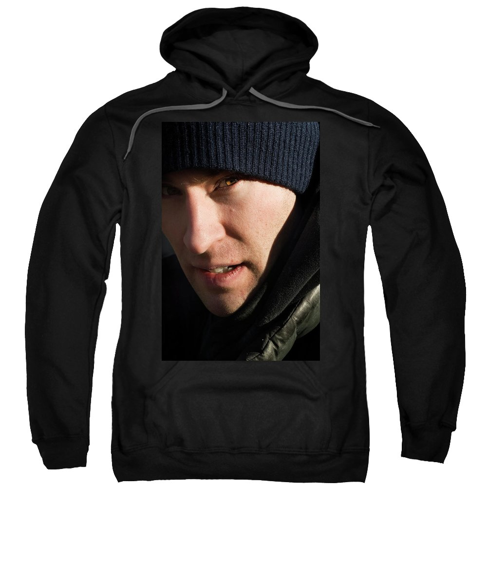 Athelete Sweatshirt featuring the photograph A Man Looks Up After Examining by Andrew Kornylak