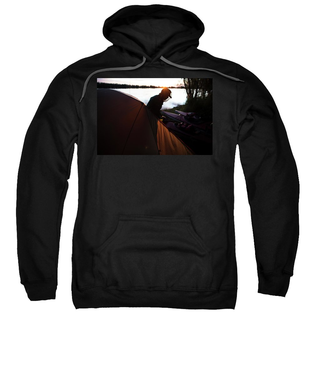 30-34 Years Sweatshirt featuring the photograph A Woman Exits The Tent At Sunset by Krystle Wright