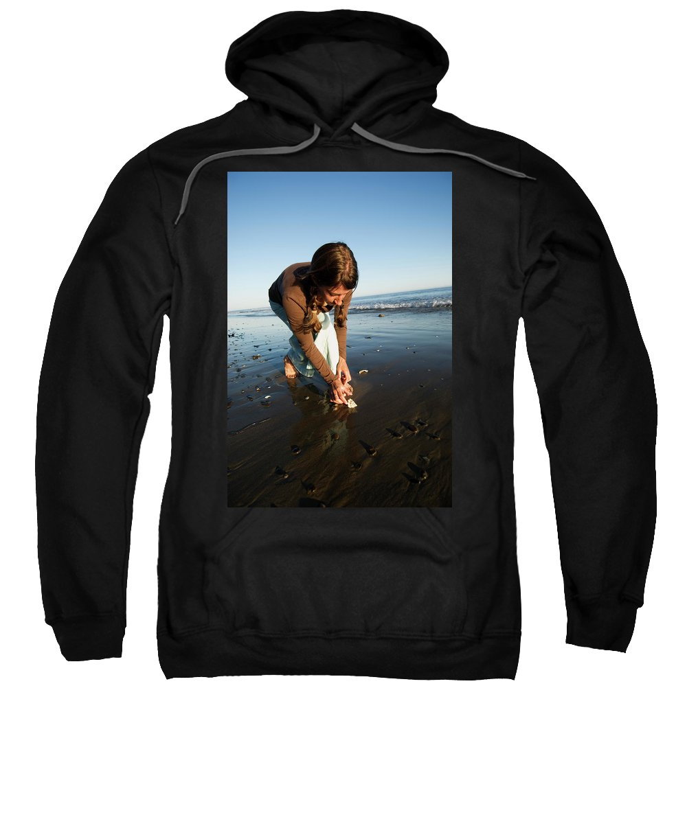 Attractive Sweatshirt featuring the photograph A Young Woman Collects Seashells by Kyle George