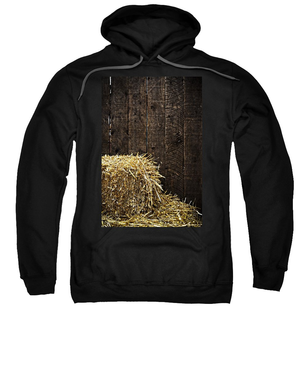 Straw Sweatshirt featuring the photograph Bale Of Straw And Wooden Background by Dutourdumonde Photography