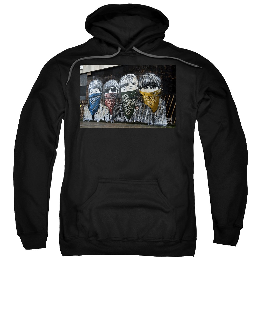 Banksy Sweatshirt featuring the photograph The Beatles wearing face masks street mural by RicardMN Photography