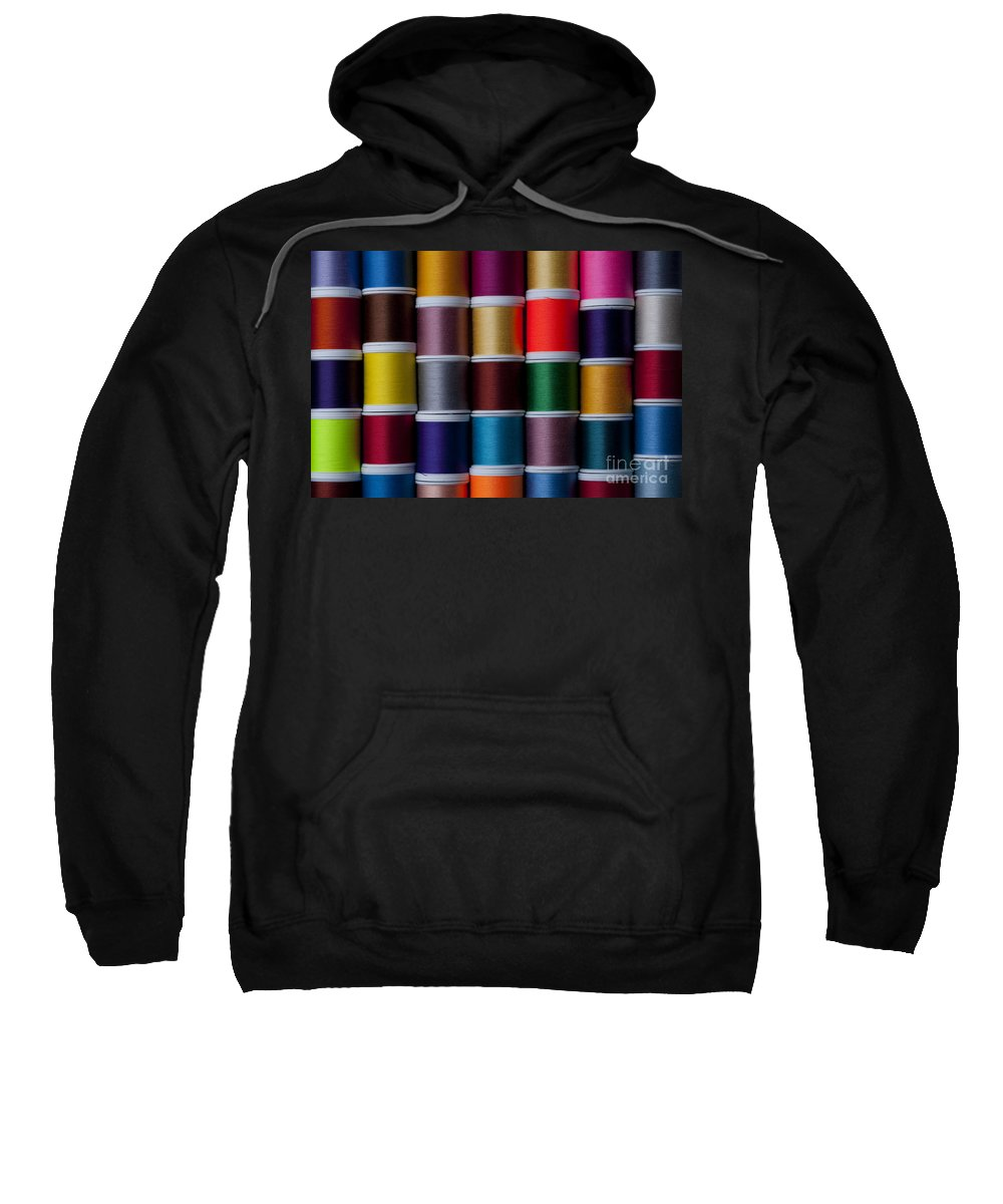 Abundance Sweatshirt featuring the photograph Bright Colored Spools Of Thread by Jim Corwin