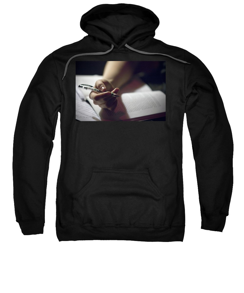 Anticipation Sweatshirt featuring the photograph Close-up Of A Hand Holding A Pen by Ron Koeberer